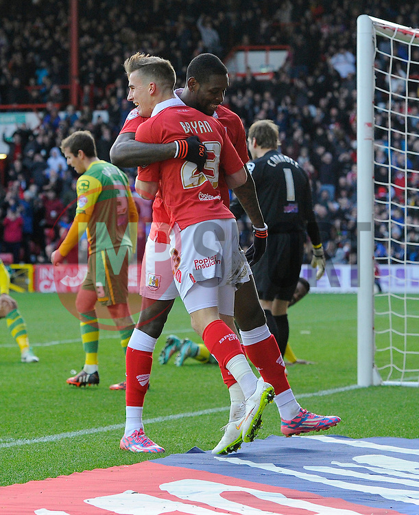 Bristol City's Joe Bryan celebrates with fellow goal scorer Bristol City's Jay Emmanuel-Thomas  - Photo mandatory by-line: Joe Meredith/JMP - Mobile: 07966 386802 - 10/01/2015 - SPORT - football - Bristol - Ashton Gate - Bristol City v Notts County - Sky Bet League One