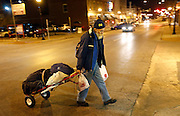 Homeless veteran Kenneth Bailey, who's street name is Wulf, walks across W Walnut Street on his way to the bus station on Wednesday, Jan. 6, 2016. Wulf and his friend will stay at the E. Sunshine Church of Christ on nights when the temperature in below 32 degrees. This night the church was closed because it was too warm so he was taking the bus to his sleeping spot.