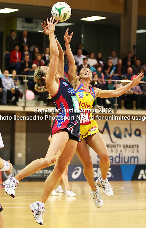 Vixens' Julie Corletto and Pulse's Ngarama Milner-Olsen compete for the teh ball during the ANZ Netball Championship, Haier Pulse v Vixens at Te Rauparaha Arena, Porirua, New Zealand on Monday 25th of June 2012. Photo: Justin Arthur / photosport.co.nz