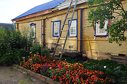 "Summer flowers alongside a house undergoing restoration in Uglich, Russia. As one of Russia's ""Golden Ring"" cities, Uglich is designated a town of significant cultural importance."