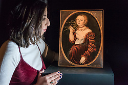 "© Licensed to London News Pictures. 01/12/2017. London, UK.  A staff member views ""Lucretia"", 1525, by Lucas Cranach the Elder, (Est. GBP400-600k).  Preview of ""Masters of Light"", Sotheby's Old Masters Evening Sale which will take place on 6 December at Sotheby's, New Bond Street. Photo credit: Stephen Chung/LNP"