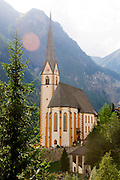 Holy Vincent pilgrimage church with Mt. Grossglockner in background, Heiligenblut, Hohe Tauern Range, Carinthia, Austria, Europe