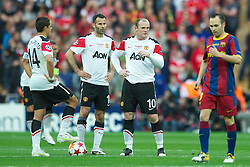 28.05.2011, Wembley Stadium, London, ENG, UEFA CHAMPIONSLEAGUE FINALE 2011, FC Barcelona (ESP) vs Manchester United (ENG), im Bild Manchester United's Javier Hernandez, Ryan Giggs and Wayne Rooney look dejected after FC Barcelona score the opening goal during the UEFA Champions League Final at Wembley Stadium, EXPA Pictures © 2011, PhotoCredit: EXPA/ Propaganda/ Chris Brunskill *** ATTENTION *** UK OUT!