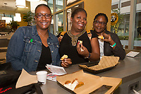 The Hyde Park Chamber of Commerce held a dinner crawl Tuesday, October 3rd, 2017 along both 53rd street and 57th street.<br /> <br /> 0385 &ndash; Jennifer Reid, Demetris Hogan and Alisha Cole enjoy samplings from Einstein&rsquo;s Brothers Bagels located at 5225 S. Harper Court.<br /> <br /> Please 'Like' &quot;Spencer Bibbs Photography&quot; on Facebook.<br /> <br /> Please leave a review for Spencer Bibbs Photography on Yelp.<br /> <br /> All rights to this photo are owned by Spencer Bibbs of Spencer Bibbs Photography and may only be used in any way shape or form, whole or in part with written permission by the owner of the photo, Spencer Bibbs.<br /> <br /> For all of your photography needs, please contact Spencer Bibbs at 773-895-4744. I can also be reached in the following ways:<br /> <br /> Website &ndash; www.spbdigitalconcepts.photoshelter.com<br /> <br /> Text - Text &ldquo;Spencer Bibbs&rdquo; to 72727<br /> <br /> Email &ndash; spencerbibbsphotography@yahoo.com