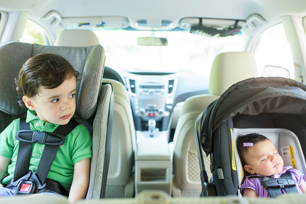 Pikesville, Maryland - June 25, 2015:  Car Seat Lady Alisa Baer's nephew and niece demonstrate the preferred way to seat children in a car, back-facing. <br /> Eitan Aghion, 2, sits in a Clek Foonf convertible car seat ($400-$550), and his seven-week old sister, Leora Aghion, sits in a Nuna Pipa infant seat ($300), outside their house in Pikesville, Maryland. <br /> <br /> Alisa Baer, 35, and Emily Levine, 34, both from Manhattan and Alisa's mother Deborah Baer, 67, from Pikesville, Maryland operate The Car Seat Lady blog and car seat installation classes available in New York and Maryland. <br /> <br /> CREDIT: Matt Roth for The New York Times<br /> Assignment ID: 30176354A