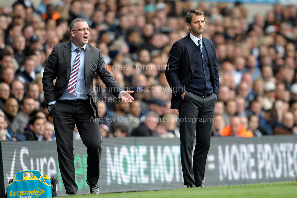 Aston Villa's head coach Paul Lambert and Tottenham Hotspur Manager Tim Sherwood (r) watching their players during the first half, Barclays premier league match ,Tottenham Hotspur v Aston Villa at White Hart Lane in Tottenham, London  on Sunday 11th May 2014.<br /> pic by John Patrick Fletcher, Andrew Orchard sports photography.