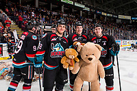 KELOWNA, CANADA - DECEMBER 1:  Leif Mattson #28 Lassi Thomson #2 and Kyle Topping #24 of the Kelowna Rockets pose on the ice with a teddy bear against the Saskatoon Blades on December 1, 2018 at Prospera Place in Kelowna, British Columbia, Canada.  (Photo by Marissa Baecker/Shoot the Breeze)