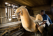 Apprentice coffin maker Jonathan Aduful  adjusts the lid of a chicken-shaped coffin, ordered for a poultry farmer, at the Hello Design Coffins shop in Teshie, on the outskirts of Ghana's capital Accra, on Tuesday December 9, 2008.