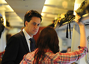 © Licensed to London News Pictures. 16/03/2012. London, UK. Ed miliband talks with a member of the public on the train. Leader of the Labour Party, Ed Miliband and members of his Shadow Cabinet travel to Labour's Youth Conference in Coventry this morning, 16 March 2012, by train from London Euston Station. Photo credit : Stephen SImpson/LNP