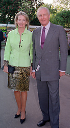 MR & MRS GALEN WESTON he is the multi millionaire, at <br /> the Chelsea Flower show in London on 22nd May 2000.OEJ 23