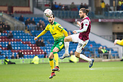 Norwich City midfielder Mario Vrančić (8) challenged by Burnley forward Jay Rodriguez (19) during the The FA Cup match between Burnley and Norwich City at Turf Moor, Burnley, England on 25 January 2020.