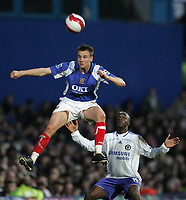 Photo: Lee Earle.<br /> Portsmouth v Chelsea. The Barclays Premiership. 03/03/2007.Chelsea's Lassana Diarra (R) watches as Portsmouth's Matthew Taylor clears.