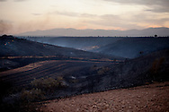 Fields are seen burned during a forest fire near El Cubillo de Uceda, on August 11, 2012 in Guadalajara, Spain. During a heat wave dozens of forest fires have appeared in Spain, three of them at National Parks, like Teide, Doñana or Cabañeros, and thousands of people had to be evacuated at La Gomera and Tenerife, in the Canary Islands.