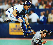 1990 American League Championship Series Toronto Bluejay's catcher Pat Borders attempts to tag out Minnesota's Dan Gladden at home plate.  Gladden was safe, tying the game.