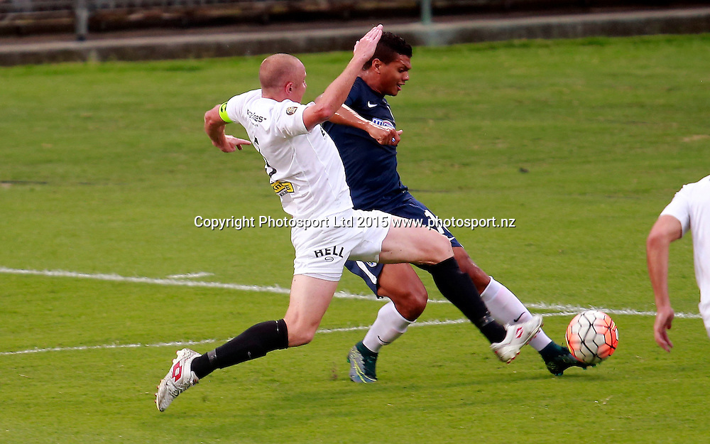 Auckland's Ryan De Vries is tackled by Wellington's Bill Robertson. ASB Premiership, Round Four, Auckland City FC v Team Wellington, QBE Stadium Auckland, Thursday 28th January 2016. Copyright Photo: Shane Wenzlick