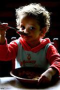 Betim_MG, Brasil...Creche Comunitaria Cantinho Feliz em Betim. Na foto garoto comendo...Cantinho Feliz ommunity nursery in Betim. In this photo a boy eating...FOTO: LEO DRUMOND / NITRO