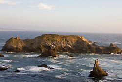 Steep cliffs and rocks line the shore of the Pacific Ocean along California Highway 1 (The Shoreline Highway) in northern Mendocino County, California.