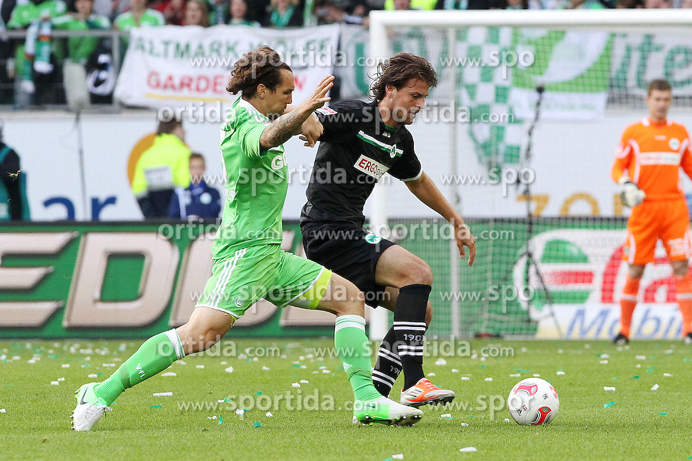 22.09.2012, Volkswagen Arena, Wolfsburg, GER, 1. FBL, VfL Wolfsburg vs SpVgg Greuther Fuerth, 4. Runde, im Bild Emanuel POGATETZ (VfL Wolfsburg), Ilir Azemi (Greuther Fuerth, Nr. 33), -Aktion, Action, // during the German Bundesliga 4th round match between VfL Wolfsburg and SpVgg Greuther Fuerth at the Volkswagen Arena, Wolfsburg, Germany on 2012/09/22. EXPA Pictures © 2012, PhotoCredit: EXPA/ Eibner/ Holger Sieglitz..***** ATTENTION - OUT OF GER *****