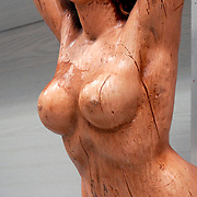 Nude Folk Art Mermaid figurehead is a carved wooden decoration from the prow of ship  in Maritime Museum.