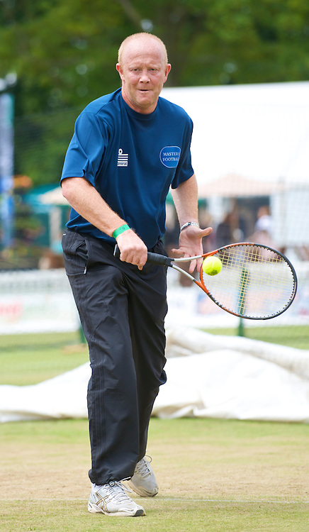 LIVERPOOL, ENGLAND - Saturday, June 20, 2009: Former Liverpool FC player Mark Wright during a Pro-Am with Michael Stich (GER) during Day Four of the Tradition ICAP Liverpool International Tennis Tournament 2009 at Calderstones Park. (Pic by David Rawcliffe/Propaganda)
