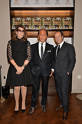 Left to right, MARTINE ASSOULINE, VALENTINO GARAVANI and PROSPER ASSOULINE at a party to celebrate the launch of the Maison Assouline Flagship Store at 196a Piccadilly, London on 28th October 2014.  During the evening Valentino signed copies of his new book - At The Emperor's Table.