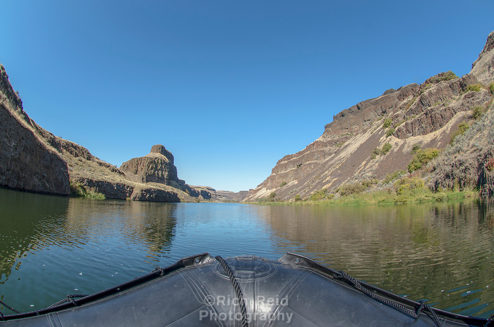 POV from an inflatable craft  of the scablands on the Palouse River in Southeastern Washington.