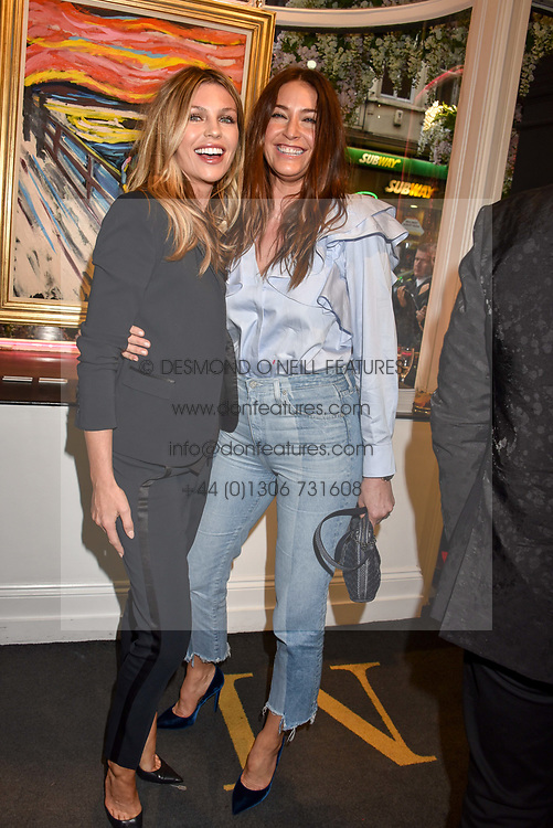 Left to right, Abbey Clancy and Lisa Snowdon at a private view of work by Bradley Theodore entitled 'The Second Coming' at the Maddox Gallery, 9 Maddox Street, London England. 19 April 2017.