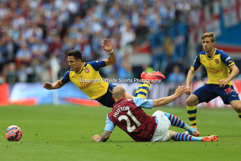 30 May 2015 -FA Cup Final 2015 - Aston Villa v Arsenal - Alan Hutton of Aston Villa  fouls Alexis Sanchez of Arsenal - Photo: Marc Atkins / Offside.