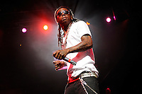 Lil Wayne performing at the Chaifetz Arena in St. Louis. August 30, 2008. © Todd Owyoung/Retna Ltd.