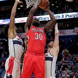 Nov 28, 2018; New Orleans, LA, USA; New Orleans Pelicans forward Julius Randle (30) shoots over Washington Wizards forward Devin Robinson (7) and guard Tomas Satoransky (31) during the fourth quarter at the Smoothie King Center. Mandatory Credit: Derick E. Hingle-USA TODAY Sports