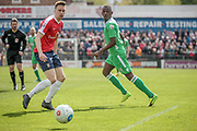 Ntumba Massanka (on loan from Burnley) (Wrexham AFC) watches as his pass cuts out the York City defender and sets up another attack during the Vanarama National League match between York City and Wrexham FC at Bootham Crescent, York, England on 17 April 2017. Photo by Mark P Doherty.