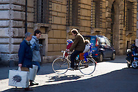 rome; italy; tourist; shoppers; residents; cross; paths; intersection; via di pasquino; piazza novana; bike; bicylce; family; father; children; kids; architecture; built; city; europe; famous; place; old; tourism; traditional; culture; travel; urban; scene; beautiful; transportation; cities; location; civilization; cobblestone; mode; pedestrian; pedestrians; street; road; alley; roma; vacation; leisure; activity; outdoors; destinations; cheerful; people; sightseeing; attraction; capital; contemporary; day; lazio; mediterranean; countries; outdoor; square; squares; color; colour; colorful; colourful; people; person; persons; horizontal;
