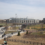 Fans head to Yankee Stadium during the New York Yankees Vs Toronto Blue Jays season opening day at Yankee Stadium, The Bronx, New York. 6th April 2015. Photo Tim Clayton