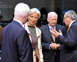 Christine Lagarde, France's finance minister, second from left, speaks with Allistar Darlling, the UK's chancellor of the exchequer, left, while Jean-Claude Juncker, Luxembourg's prime minister, right, speaks with Philippe Maystadt, president of the European Investment Bank, during the meeting of European finance ministers, at EU Council headquarters in Brussels, Belgium, on Tuesday, Feb. 16, 2010. (Photo © Jock Fistick)