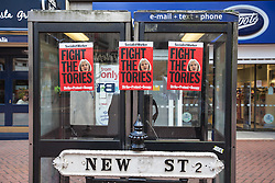© Licensed to London News Pictures. 02/10/2016. Birmingham, UK. 'Fight the Tories' posters attached to phone boxes on New Street in Birmingham ahead of a national demonstration against the policies of Britain's Conservative government. The Conservative Party conference begins today at the ICC in Birmingham and is the first under the leadership of Prime Minister Theresa May, who took over after David Cameron's resignation in July 2016. Photo credit: Rob Pinney/LNP