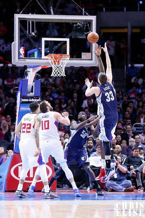23 February 2015: Memphis Grizzlies center Marc Gasol (33) goes for the sky hook over Los Angeles Clippers center DeAndre Jordan (6) during the Memphis Grizzlies 90-87 victory over the Los Angeles Clippers, at the Staples Center, Los Angeles, California, USA.