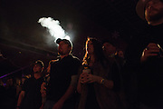 Fans enjoy cigarettes and beer as Holy Moly performs at Billy Bob's Texas in Fort Worth, Texas on December 13, 2012.  (Stan Olszewski/The Dallas Morning News)
