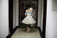 One of the lead ballerinas from the  National Ballet of China heads to rehearsal at  the National Ballet's studio in Beijing, China, Friday, Aug. 21, 2009.  For Chinese, ballet is tangled up with China's blood-soaked revolutionary past, arriving here in the 1950s on a wave of pro-Soviet fervor and quickly repurposed as a propaganda weapon during the Cultural Revolution.