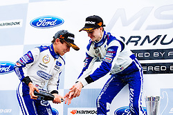 Lando Norris sprays the Champagne after he takes the Win in his first race of the weekend (joined on the podium by his 2nd placed teammate Colton Herta) | #31 Carlin | MSA Formula Championship | Race 1 - Mandatory byline: Rogan Thomson/JMP - 07966 386802 - 10/10/2015 - MOTORSPORT - Brands Hatch GP Circuit - Fawkham, England - BTCC Meeting Day 1.