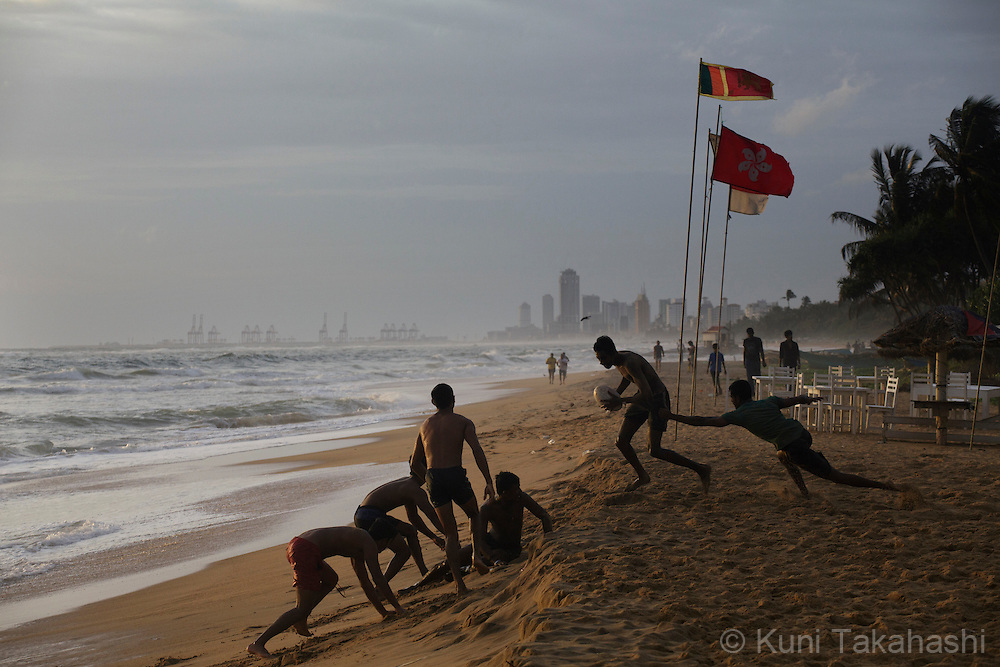 Men play rugby at Mount Lavinia Beach in Colombo, Sri Lanka on July 22, 2015. The golden beach with several seafood restaurants is located in one of Colombo's more laid-back suburb town.<br /> (Photo by Kuni Takahashi)