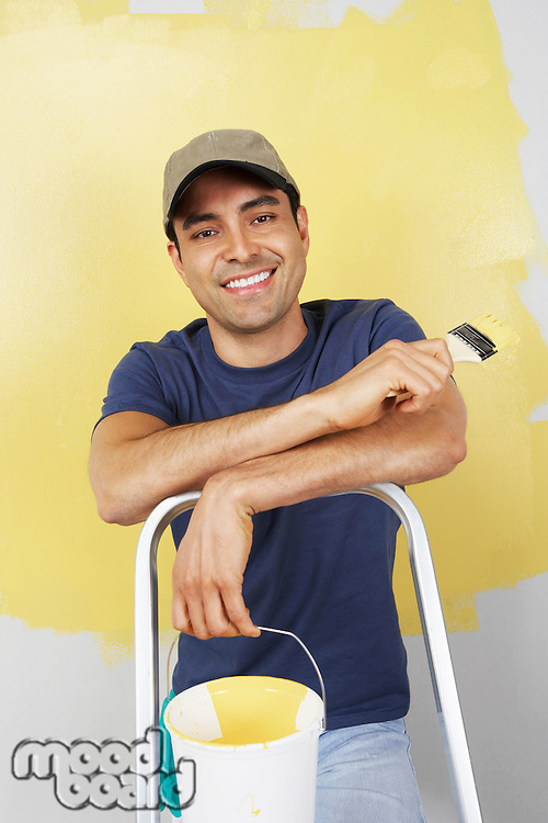 Man Painting Room Yellow