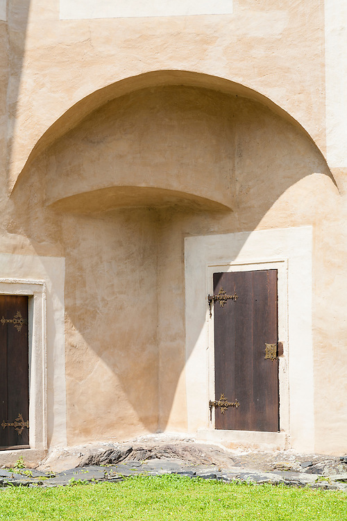 architectural detail of stucco plaster wall and doors of historic castle outside Vienna Austria