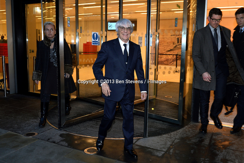 Bernie Ecclestone leaves the High Court after giving evidence in relation to an alleged fraudulent deal selling a stake in Formula One, London, United Kingdom. Wednesday, 6th November 2013. Picture by Ben Stevens / i-Images<br /> File photo - The Formula One boss, Bernie Ecclestone, has offered to make a $100m (£60m) payment to end his trial on bribery charges, a district court in Munich has said. State prosecutors told the court they would agree to accept his offer. Photo file 05/08/2014.