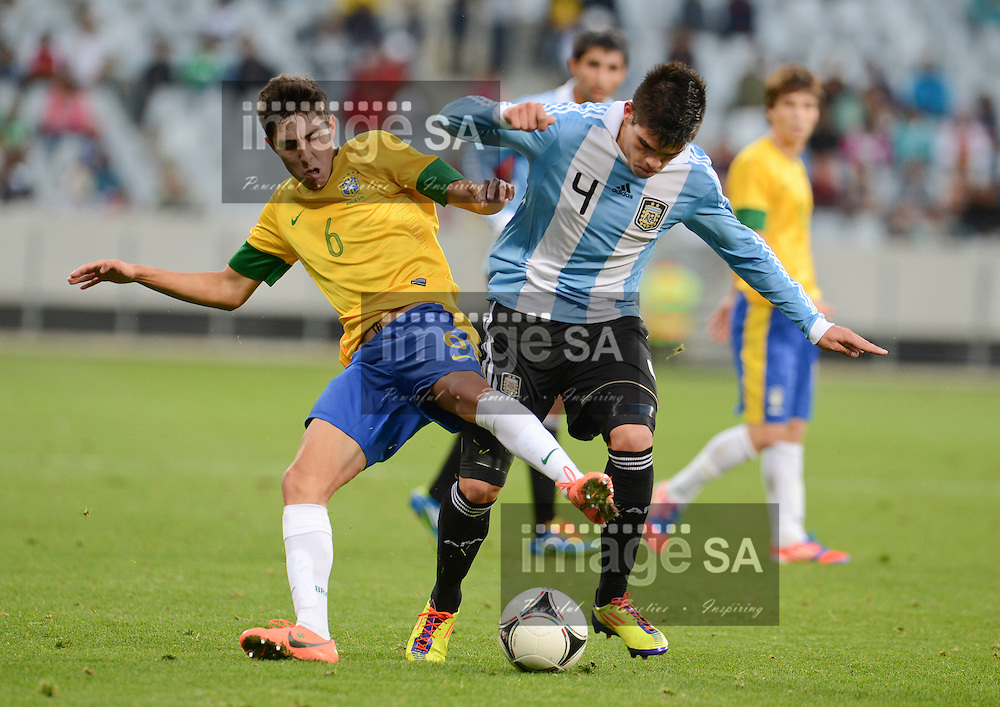 CAPE TOWN, SOUTH AFRICA: Sunday 3 June 2012, HENRIQUE MIRANDA RIBEIRO of Brasil is challenged by ALAN AGUIRRE of Argentina during the final of the under 20 Cape Town International Soccer Challenge between Argentina and Brazil at the Cape Town Stadium..Photo by Roger Sedres/ImageSA