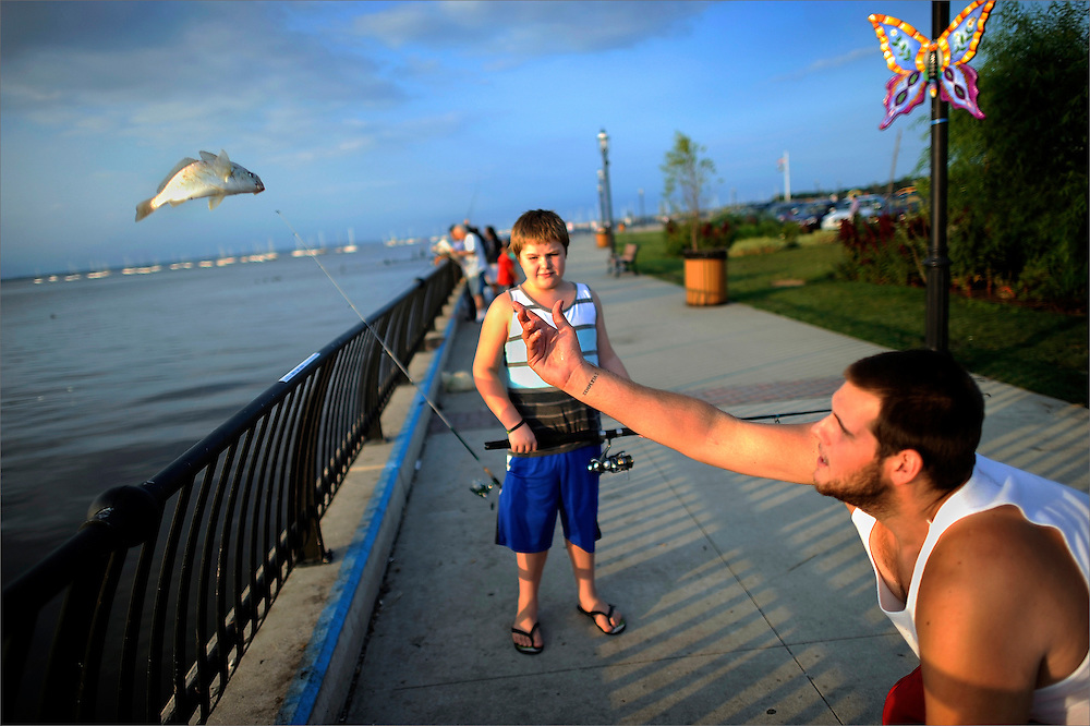 Nine-year old Gavin Lemkul (middle) and Eddie Lemkul (right) both of Union Beach throw back their catch along the Raritan Bay in Keyport on August 29. Photo essay from throughout the Jersey Shore, New Jersey