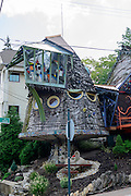 Photo of the Mushroom House in the Hyde Park neighborhood of Cincinnati, Ohio, at the corner of Erie and Tarpis, was created by Terry Brown, a Professor of Architecture and Interior Design at the University of Cincinnati, with help from university students.