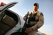 Border patrol agent John Bernal in pursuit of traffickers .Tucson, AZ.12/8/05.photos: Hector Emanuel