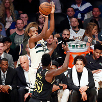 30 March 2018: Milwaukee Bucks forward Khris Middleton (22) takes a jump shot during the Milwaukee Bucks 124-122 victory over the LA Lakers, at the Staples Center, Los Angeles, California, USA.