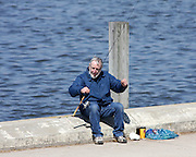Fishing is a beloved pastime for many people, myself included. In the spring, when the walleyes migrate into the Fox River from Green Bay, kids from 8 to 80, including this gentleman, line up along the shoreline at Voyageur Park in De Pere, in hopes of catching a trophy.