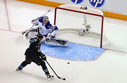 April 14, 2011; San Jose, CA, USA; San Jose Sharks right wing Dany Heatley (15) scores a goal past Los Angeles Kings goalie Jonathan Quick (32) during the first period at HP Pavilion. The Sharks defeated the Kings 3-2. Mandatory Credit: Jason O. Watson / US PRESSWIRE